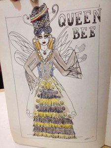 Queen Bee in sequined tassle gown