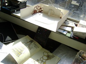 Set model on Kat's desk, with costume design sketch book