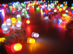Many small different coloured LED lights scattered on a surface
