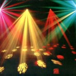 different coloured disco lights shining onto dance floor