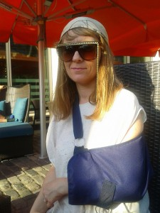 Sophie Woolley with arm in a blue sling